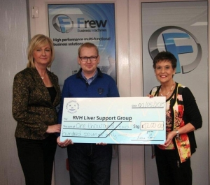 Founder Kay Duffy receives the cheque from Gloria and Daniel Fletcher