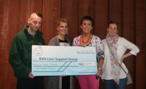 Kay Duffy receives the cheque on behalf of the support group