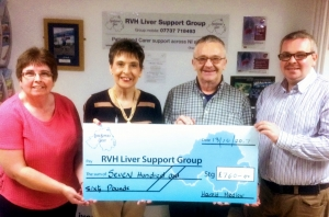 Harold Medlow presents a cheque to Founder, Kay Duffy. Also in the photo are his wife and son.