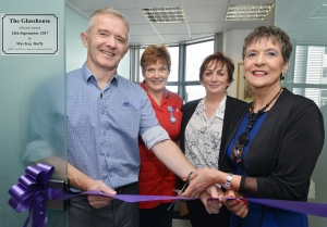 Kay Duffy cuts the ribbon at the official opening as Dr McDougall, Sr Sharon Moffett and Angela Costello look o.