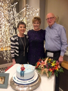 Kay Duffy (Founder} on the left and Gordon Cave (President) on the right pose with Sr Moffett at her retirement function.