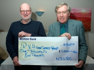Ivar Aicken receives the cheque from Gordon McIlwaine (NILRC President)