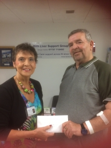 Paul Kearney makes his presentation to Kay Duffy, founder of RVH Liver Support Group