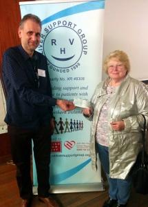 Joyce Britt presents her cheque to the treasurer Tom McCready