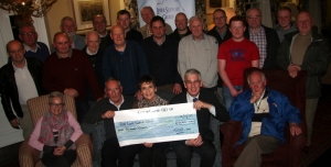 Presentation of the cheque with front row, L to R Glynis Graham, Alan Graham (Chair of the Association, Kay Duffy, Donald Cairnduff and Robert Begga, Secretary of the Association