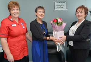 Kay receives a bouquet of flowers from Angela Costello, with Sharon Moffett.